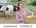 Smiling Young Farmer Carrying...