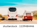 rv camper car and bus on road....