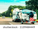 rv camper car with motor boat... | Shutterstock . vector #1139484449