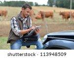 breeder in farm using digital... | Shutterstock . vector #113948509