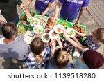 volunteers serving food for... | Shutterstock . vector #1139518280