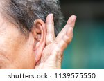senior woman's hand holding...   Shutterstock . vector #1139575550