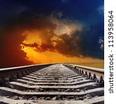 railroad goes to dramatic sunset - stock photo