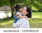 adorable asian granddaughter is ... | Shutterstock . vector #1139582213