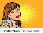Woman Looking In Smartphone....