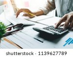 accountant working on... | Shutterstock . vector #1139627789