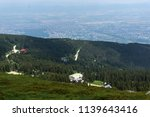 panorama with green hills at... | Shutterstock . vector #1139643416