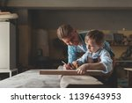 master and apprentice at work... | Shutterstock . vector #1139643953