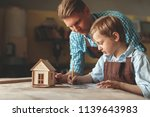 young family with a wooden... | Shutterstock . vector #1139643983
