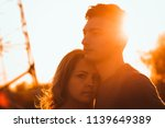 guy and girl in the field on...   Shutterstock . vector #1139649389