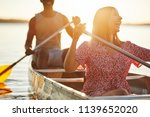 laughing young woman paddling a ... | Shutterstock . vector #1139652020