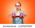 senior beautiful woman with a... | Shutterstock . vector #1139659304