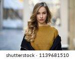 blonde woman in urban... | Shutterstock . vector #1139681510