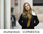 blonde woman in urban... | Shutterstock . vector #1139681516