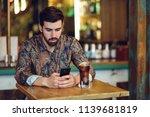 young bearded man wearing... | Shutterstock . vector #1139681819