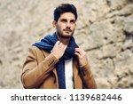 young man wearing winter... | Shutterstock . vector #1139682446