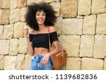 happy mixed woman with afro... | Shutterstock . vector #1139682836