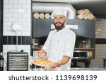 smiling bearded pizzaiolo... | Shutterstock . vector #1139698139