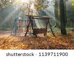swings on children playground... | Shutterstock . vector #1139711900