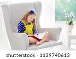 child reading book. kids read... | Shutterstock . vector #1139740613