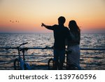 Silhouette Of A Couple With...