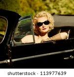 Woman In Retro Car