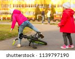 a little girl in safety gear ... | Shutterstock . vector #1139797190