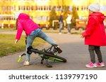 a little girl in safety gear ... | Shutterstock . vector #1139797190