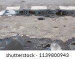 the old asphalt street in a town | Shutterstock . vector #1139800943