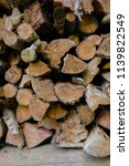 pile of firewood backgrounds... | Shutterstock . vector #1139822549