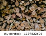 pile of firewood backgrounds... | Shutterstock . vector #1139822606