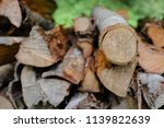 pile of firewood backgrounds... | Shutterstock . vector #1139822639