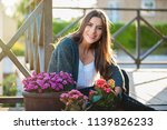 beautiful young woman smiling... | Shutterstock . vector #1139826233