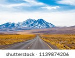 a long straight road with... | Shutterstock . vector #1139874206