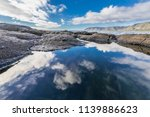 sky reflections on water at ... | Shutterstock . vector #1139886623