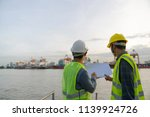 man inspect container in port | Shutterstock . vector #1139924726