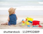 asian baby boy playing sand on... | Shutterstock . vector #1139932889