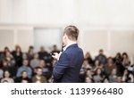 successful businessman holds... | Shutterstock . vector #1139966480
