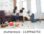 happy asian family in living... | Shutterstock . vector #1139966753