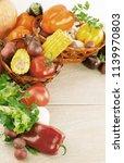 frame of fresh vegetables on a... | Shutterstock . vector #1139970803