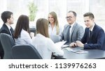 business team holds a workshop... | Shutterstock . vector #1139976263