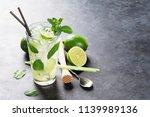 mojito cocktail on dark stone... | Shutterstock . vector #1139989136