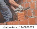 real construction worker... | Shutterstock . vector #1140023279