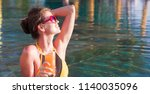 beautiful woman with tropical... | Shutterstock . vector #1140035096