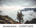 Foggy Mountain Landscape At...