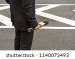 microphone in hand in the city... | Shutterstock . vector #1140073493