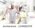 funny cheerful chef in white...   Shutterstock . vector #1140082559