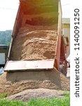 truck unloads sand for... | Shutterstock . vector #1140091250