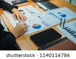 business team working planning... | Shutterstock . vector #1140116786
