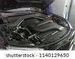 a car engine compartment being ... | Shutterstock . vector #1140129650